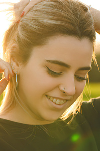 320x568 Girl Smiling Adjusting Back Hairs 4k