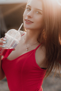 Girl Smiling Drink In Hands