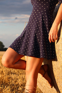 Girl Standing In A Field Wearing Polka Dot Dress