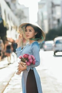 Girl Standing With Bouquet Flowers