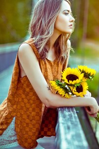 Girl Standing With Sun Flowers