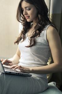 Girl Using Laptop 5k
