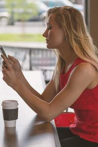 240x320 Girl Using Phone