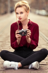 240x320 Girl With Camera Sitting On Tram Road
