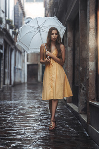 Girl With Umbrella In Yellow Dress