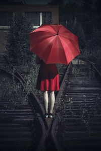 Girl With Umbrella On The Railway