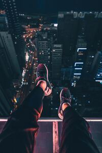Hanging Shoes In Air City Night View 4k