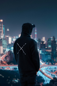 750x1334 Hoodie Man Looking At City View 4k