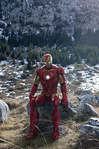 Iron Man Sitting On Stone Mountains