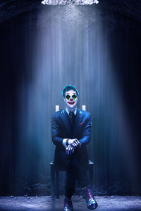 240x320 Joker Sitting On Chair
