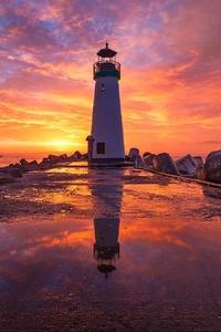 Lighthouse At Sunsrise