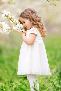 Little Cute Girl Smelling Flowers