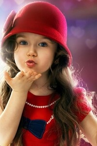 640x1136 Little Girl Blowing a Kiss
