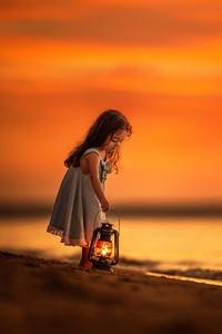 Little Girl On Beach Near Shutdown With Her Lantern