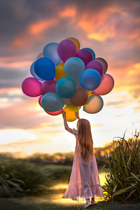 1080x2280 Little Girl With Colorful Balloons
