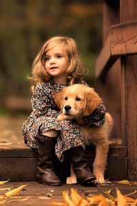 640x960 Little Girl With Golden Retriever Puppy
