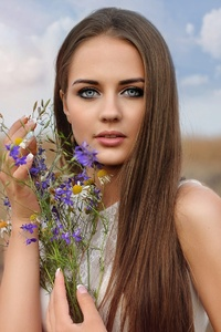 1440x2560 Long Hair Brunette With Flowers In Hand Field
