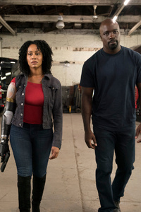 640x960 Luke Cage Misty Knight With Bionic Arm