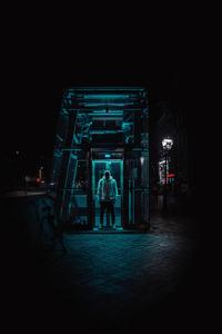 Man Standing Under Structure