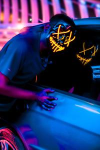 320x480 Mask Guy Alongside With Car