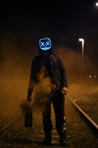 Mask Guy Walking On Railroad
