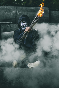 720x1280 Mask Guy With Bonefire