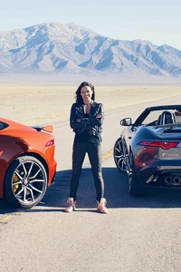 Michelle Rodriguez With Jaguar Sports Car