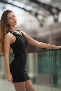 Model In Black Mini Dress