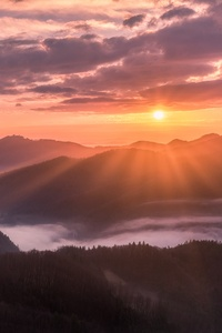 1080x2280 Mountains Fog Sunbeams Clouds 5k
