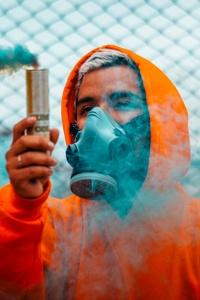 1080x1920 Orange Hoodie Guy With Smoke