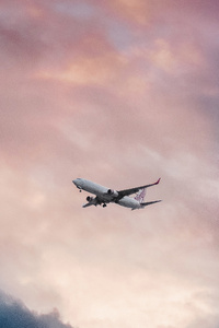 320x480 Passenger Plane In Clouds View From Far Away