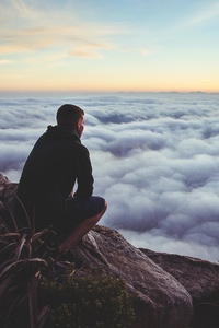 Person Looking At The Clouds From Top