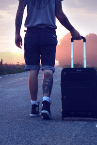 2160x3840 Person Walking On Road With Suitcase