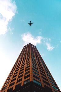 640x1136 Plane Flying Over Building 4k