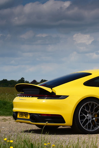 360x640 Porsche 911 Carrera 4s Yellow 2019