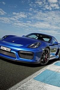 1242x2688 Porsche Cayman GT4 Blue