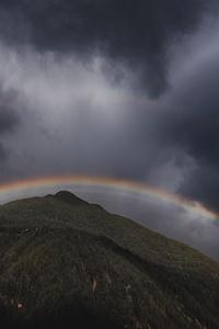 Rainbow Over Mountain Landscape