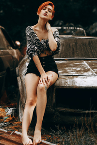 Red Head Girl Sitting On A Vintage Car 4k