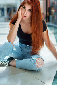 1080x1920 Red Head Girl Sitting On Floor Looking At Viewer 4k
