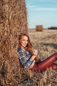 640x1136 Redhead Women Outdoors In Leather Pants