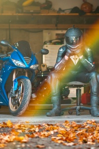 Rider With Daytona 675 Triple Sitting On Chair