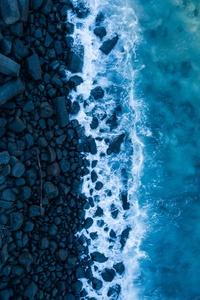 750x1334 Rocks And Sea 4k