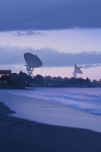 1080x2160 Satellites On The Sea Shore
