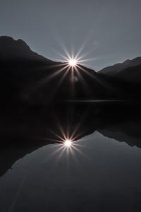 1080x2160 Silhouette Of Mountain Near Body Of Water 4k