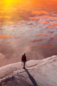 Standing At Snowy Peak Mountain Sunset