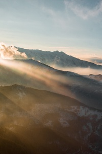 Sun Rays Through Mountains