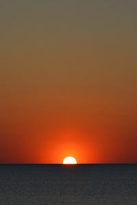Sun Setting In Body Of Water