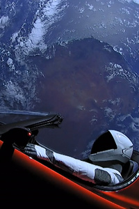 800x1280 Tesla Roadster In Space With Space Suit Man