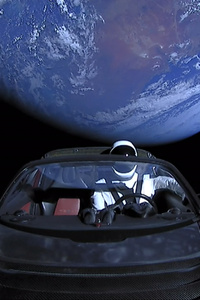 800x1280 Tesla Roadster Into Space With Space Suit Man