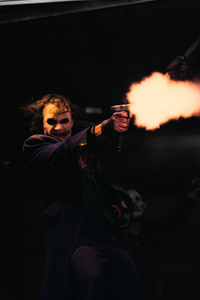 1280x2120 The Joker Firing A Glock In The Dark Knight